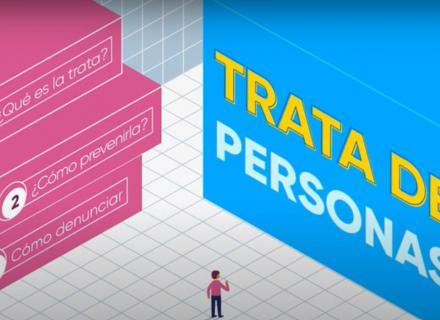 """ilustración abstracta con personaje frente a dos grandes cubos. Uno de ellos indica """"Trata de Personas"""""""