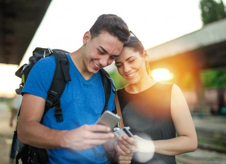 Man and woman check information on phone
